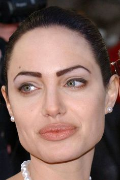 Angelina Jolie's over-plucked brows. http://beautyeditor.ca/2014/07/30/how-to-grow-back-eyebrows