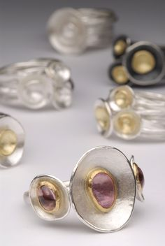 Silver and gold Apple Blossom rings. front ring with pink tourmaline. Handmade by Malcolm Morris