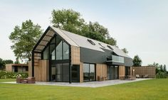 Belgian architecture firm Sito-architecten recently transformed an old barn into a stunning modern home. Located in Nukerke at the heart of the Flemish Ardennes region, the renovated building overlooks panoramic views of the hilly countryside through large windows that extend up to a high gable roof. The architects clad the home in handsome black aluminum siding and wooden slats to give the building a contemporary appearance, while complementing the rural surroundings.
