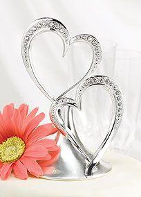 Embossed beading and sparkling rhinestones make this double heart cake top stunning. Style DBK10001 #davidsbridal #caketopper #weddingcakes
