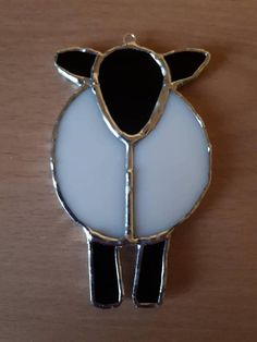 A cute little sheep suncatcher made in my small home studio. I use the Tiffany copperfoil method of stained glass making. Each piece is cut, shaped, edged with foil then soldered together to produce a beautiful piece. It measures approximately 10cm x 6cm (4 x 2.5) and comes with