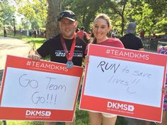 Team DKMS athlete Joh Murphy and Michele McCaffrey rooting on other team members.
