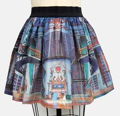 Beauty and the Beast Library skirt! (Made by GoFollowRabbits on Etsy). I think my heart literally stopped for a few seconds. Wow.
