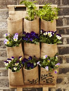 Make the most of bare walls in your garden by hanging vertical planters (by Garden Beet).