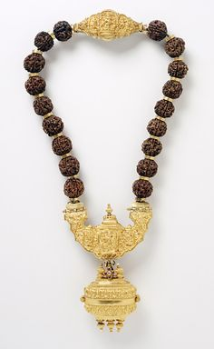 India, Tamil Nadu | Necklace with Shiva's Family, late 19th century  |  Gold inlaid with rubies and a diamond;