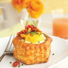Pepperidge Farm® Puff Pastry:Bacon, Egg and Cheese Pastry Shells Eggs are baked in puff pastry shells and then garnished with bacon, cheese and fresh chives