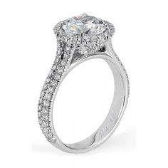 Double row diamond engagement features sparkling pave diamonds on both the band and halo which surround a round center of your choice with diamonds accenting the basket by Michael M.