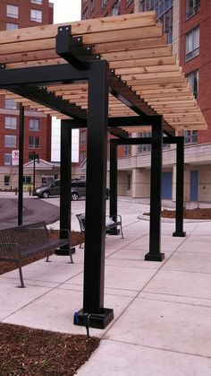 Awesome pergola on one of our ICI projects cedar and steel a tremendous combination! See more at www.lakeridgecontracting.ca