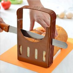 Professional Bread Cutter  Slice all breads fast and easily, which has been one of the practical tools in our daily life.  Easy to clean up, simply dump from crumb catcher.  This slicer is high enough for any size bread toast, and convenient to use.  It can be folded easily for storage or hanging on the wall, it's very space-saving.
