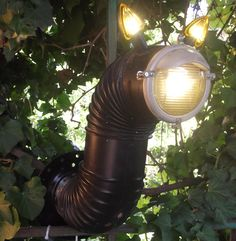 """Lighting fixture made of old chimney part and motorcycle turning lights. [symple_toggle title=""""More information"""" state=""""closed""""] Submitted by: Igal Rozenblatt ! [/symple_toggle]"""