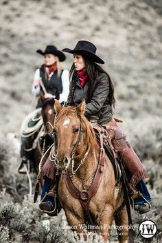 Cowgirls in wide open spaces with their horses.
