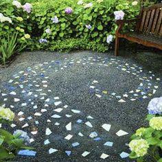 broken ceramic tiles create a celestial-inspired pattern