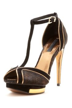 Party shoes.  black and gold high heels