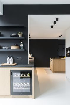 black and wood kitchen, black shelves, minimalistic modern design