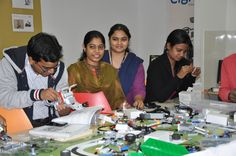 @Cigniti Technologies Teams poring over challenges on table