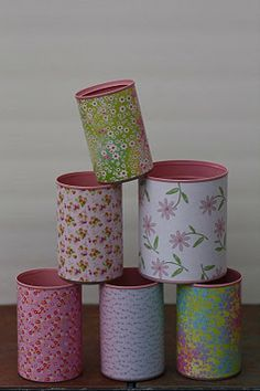 soup cans-spray paint and cover in scrapbook paper