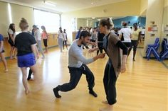 Dance teachers Dean Cross and Amelia McQueen work with students from Kings Meadows High School yesterday. Picture: WILL SWAN