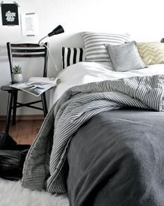 redesign your bedroom with stylish scandinavian style: contemporary bedding set ideas also black metal bedside chair on masculine scandinavian bedroom design feat brown wood floor