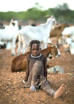 Himba girl keeping goats, Namibia | © Eric Lafforgue www.eri… | Flickr