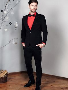 This men's styling from the Bolf collection in a modern classic offer. It's all about the black colour. The blazer, trousers and bow tie fit perfectly, as the red elegant shirt completes the outfit.