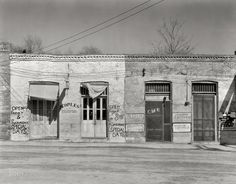 "March 1936. Edwards, Mississippi. ""Main street storefronts."" Large-format nitrate negative by Walker Evans for the Farm Security Administration."