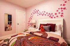 Bedroom: Fresh Childs Bedroom. teenage bedroom ideas. subtle pink bedroom. feature wall. ethnic patterned bedding. white headboard. white nightstand. wall mirror.