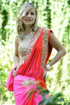 Red pink drape saree and golden enbelished choli.