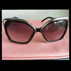 CLOSET CLEAROUT!  Fashion Sunglasses Sassy black sunnies rimmed in silver. Accessories Sunglasses