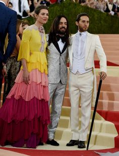 At the Met Gala, Charlotte Casiraghi in a Gucci pleated tiered chiffon gown with a silk flower and grosgrain bow detail, Creative Director Alessandro Michele in a heritage peak lapel one button brocade tuxedo and Jared Leto in a custom Gucci white satin peak lapel tailcoat with white pique cotton gilet.