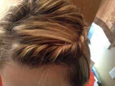 This is the French Twist!!! It's really easy to do if you just want to pull your bangs back! Email me at carly.h@att.net to if you want to know how to do this cute and simple hairstyle!! Thanks!!