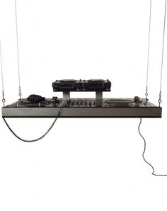 Hanging DJ booth......both weird & impractical, tho I can see the benefits, not just style.