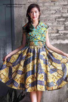 Batik Amarillis ...Batik Amarillis's Hey Day Wrap dress Our new classy & classic 50-ies dress inspired . Full skirt with large box pleats,shoulder wrap crosses bodice front and back zipper