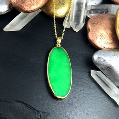 You're going to need some green in your wardrobe soon, Just sayin'.  Agate Slice Necklace Green Agate Necklace Green by AnvilAgate