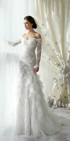 wedding dresses with sleeves, not a fan of the skirt though, just the top
