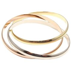 Preowned Cartier Trinity Three Color Gold Bangle Bracelet found on Polyvore featuring jewelry, bracelets, accessories, bangles, multiple, gold jewellery, gold hinged bangle, cartier jewelry, yellow jewelry and gold hinged bracelet