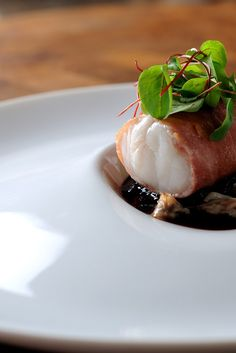 Sweet monkfish is wrapped in Parma ham in this recipe by Chris Horridge. Served with cockles, this monkfish recipe is sure to impress.