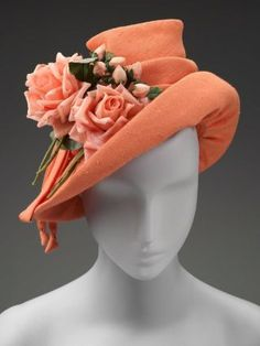 Woman's hat | American, 1940's | Materials: synthetic plain weave and silk flowers | Woman's orange 'linen' hat with orange grosgrain lining, and silk salmon roses with stems and leaves | Museum of Fine Arts, Boston