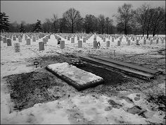 by a late winter snow in Section 60 of Arlington National Cemetery.