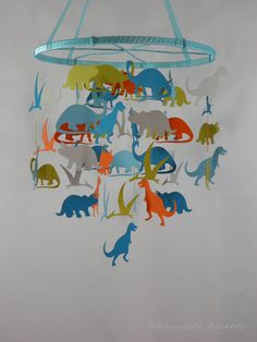 Dinosaurs Decorative Baby Mobile  Extra Large by whimsicalaccents on Etsy. This mobile will go perfectly in your nursery or your toddler's bedroom.