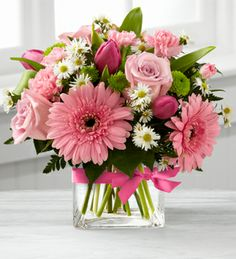 pretty pink, white daisy and roses flowers in a vase