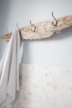 Beach towel holder made of driftwood. A nice piece of driftwood on the beach. Ein schönes Stück Treibholz am Strand gefu… Beach towel holder made of driftwood. A nice piece … -