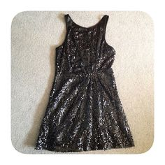 ▪️ black sequin dress ▪️ Black party dress. Sleeveless knee-length dress with layered material and topped with reflective black sequins. Sequins tend to snag easy! Zips in the back. No size on tag but fits like a medium.   no trades, paypal, & mercari  bundle for 20% discount  not smoke or pet free Dresses Midi