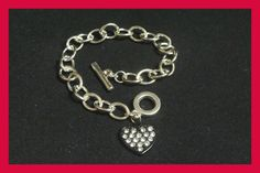 """On Sale!! Reg. $14.99...enjoy the wholesale savings!! You get three bracelets with 3 free tags  3 pretty and sexy 7"""" to 7.25 """" silver chain charm bracelets with a sleek black heart encrusted with spar"""