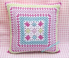 crochet cushion, granny squares in pretty, colourful, pastel shades, pink, green, blue, a lovely gift and a wonderful addition to any room.