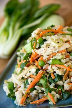 Asian-Style Brown Rice Salad in Orange Sesame-Soy Dressing with Baby Bok Choy Greens, Carrots, Petite Peas, and Shredded Chicken