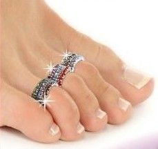 I love, love, love these.  Have to have these.  Google Image Result for http://www.iculookinatme.com/silver_Toe_Rings.jpg