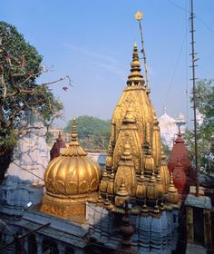 The most holy site for all sects of Hinduism ... the Kashi Vishwanath Temple with its golden domes, set on the western bank of the sacred Ganges River.