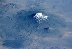 Glacier-clad Mount Arara, is Turkey's highest (5165 m), largest volume, and easternmost volcano. Its twin volcano, 3925-m-high Kucuk Ararat (or Lesser Ararat), lies across a saddle to the SE (right-center). Prominent lava flows with dramatic flow levees were erupted from flank vents between Greater and Lesser Ararat; one of these terminates in a fan-shaped lobe at the lower left. Pyroclastic-flow deposits from Ararat overlie early Bronze Age artifacts.