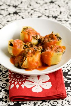 Paula Deen Northern Italian Pasta Shell Stuffing. Make it lighter by substituting: fat free cream cheese, 1 egg and 1 egg white, whole wheat pasta shells and your own or low sodium tomato sauce.