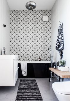 black and white bathroom decor, ornamental tiles
